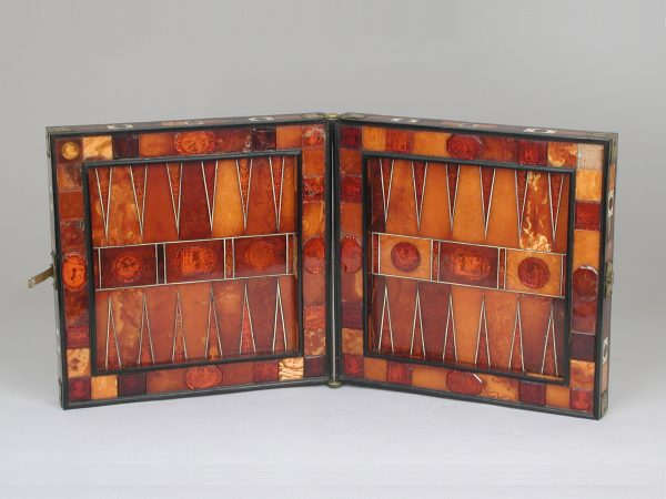 German backgammon board from the 17th century, made from amber, ivory, brass, and ebony. Metropolitan Museum of Art, 48.174.41.