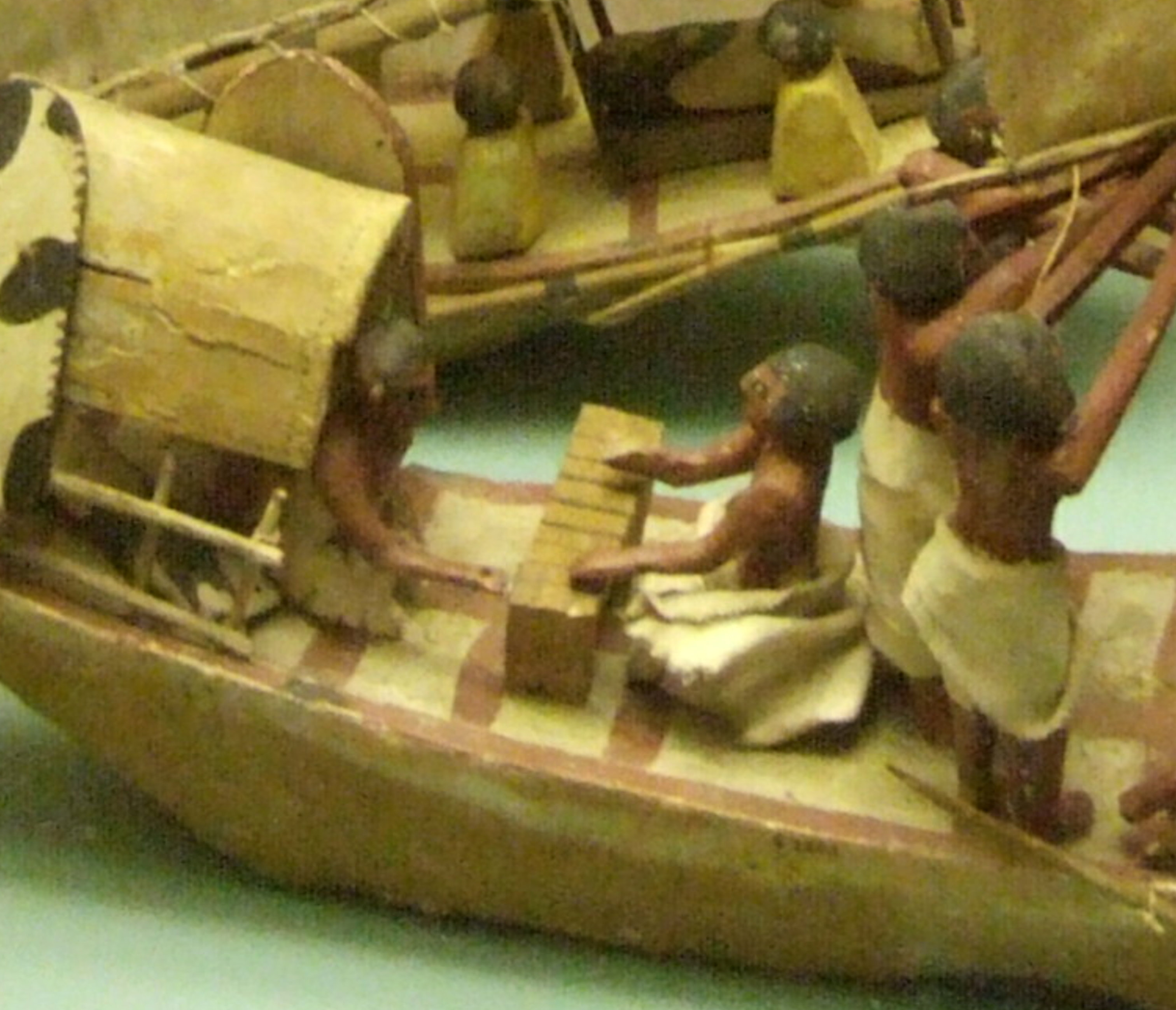 Closeup of two sailors playing the game of Men, which can be identified by vertical lines going across the gaming board. From the Tomb of Nefwa at Beni Hasan, Egypt. IXth - XIth Dynasty (c. 2125 - c. 1940 BC). Ashmolean Museum, E2301. Photo: Rex Harris, December 15, 2009.