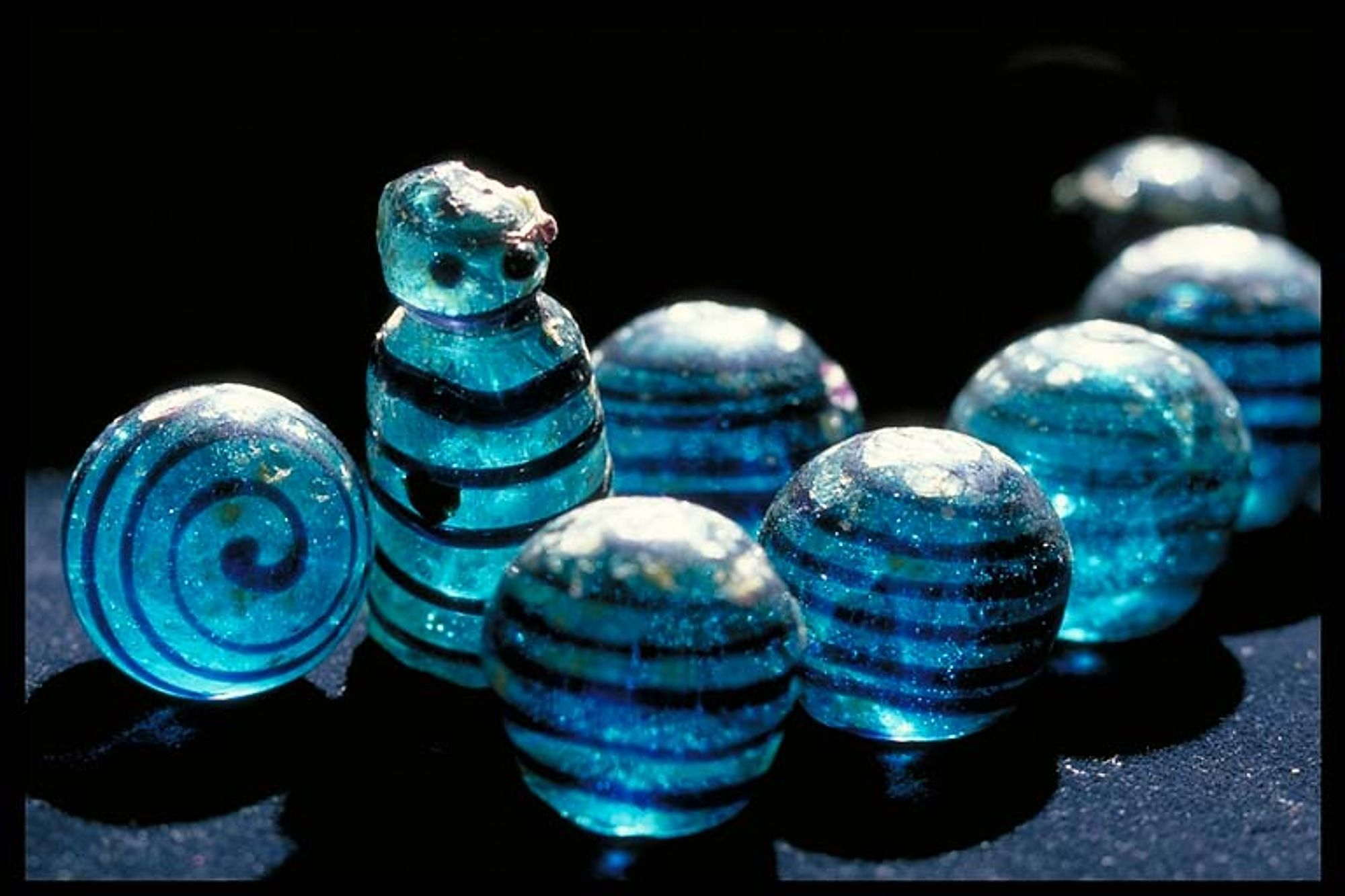 Hnefatafl Glass Pieces dated to 800 - 1099 CE, found in Björkö, Norr om Borg, Grav, Kammargrav (Bj 523). Historiska Museum, Stockholm, Sweden, 106813. Photo: December 9, 2000.