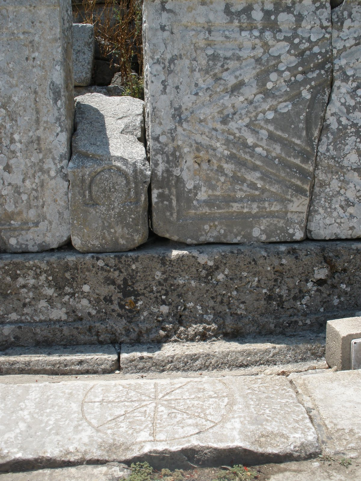 Rota carved into the floor tiles of the Marble Road in Ephesus, Turkey. Photo: Juan Carlos Campos, July, 2011.