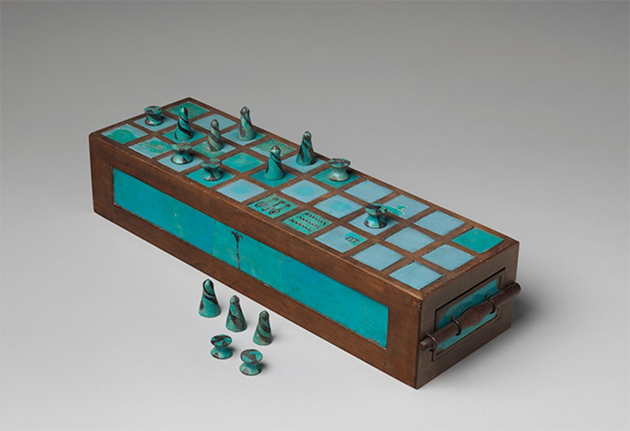 Senet game board and gaming pieces. Circa 1550–1295 BCE, Egypt, Abydos, Cemetery D. Faience, modern wood. Restored box. The Metropolitan Museum of Art, New York, Gift of Egypt Exploration Fund, 1901 - 01.4.1a-p.